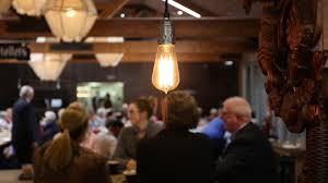 00 12 edison light bulb hanging in busy restaurant hd stock video