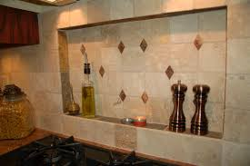kitchen stove and cream tiled backsplash with built in spicy