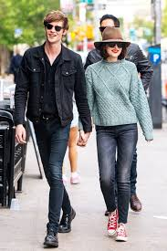 Skinny Jeans And Converse Dakota Johnson Matches Her Lipstick To Her Converse Red Converse