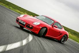 porsche cayman orange porsche cayman used car buying guide autocar