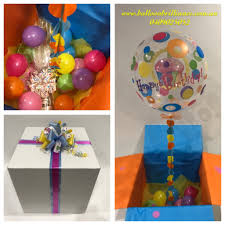 balloon in a box adding a bottle of wine to a balloon in a box delivery is