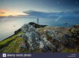 Inky Blue Inky Blue Dawn Light Over Start Bay And The Lighthouse On The