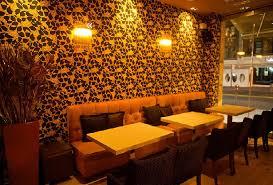 flower wallpaper and lighting design in flo cafe design home