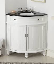 solid wood corner bathroom vanity with white vessel sink and wall
