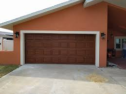 new garage door painted to look like red mahogany wood