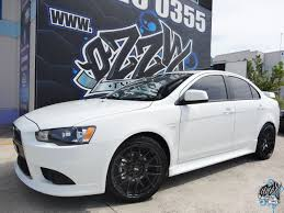 black mitsubishi lancer lancer evo black rims