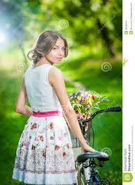 beautiful wearing a nice white dress having fun in park with