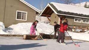 Backyard Ice Rink Tips Four Young Kids Bang Their Hockey Sticks On Backyard Ice Rink