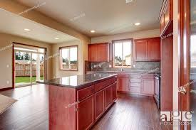stained kitchen cabinets with hardwood floors traditional kitchen with hardwood floor island and