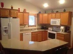 kitchen backsplash with oak cabinets and white appliances my