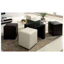 square glass top small coffee table with black and white ottomans