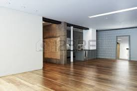 empty highrise apartment with column accent interior and hardwood