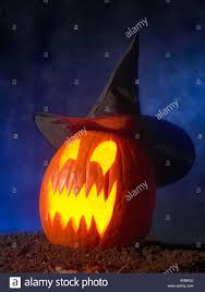 halloween jack o lantern pumpkin face witches hat stock photo