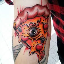 eye on pizza slice tattoo on arm
