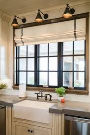 kitchen window covering ideas i like the raised window and the glass cabinets around it