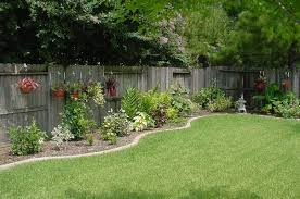 Easy Landscaping Ideas Backyard Hanging Baskets On Fence Love This Look For Against Our Fence In