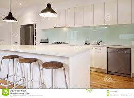 white contemporary kitchen with island stock photo image 36082060