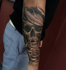 collection of 25 horror skull n roses on lower arm