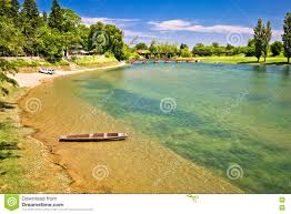 korana river beach and wooden boat stock photo image 72434546
