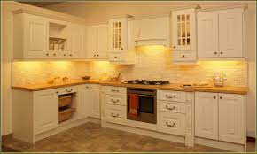 Colorful Kitchen Design by Cream Kitchen Cupboards Wood Countertops White Pendant Ivory