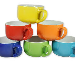 floor set for colored ceramic coffee soup mugs set together with