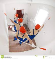 painting a wall workers painting a wall stock photo image of tray overalls