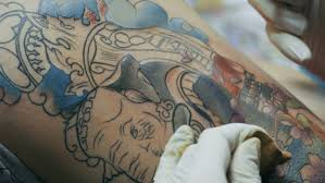 tattoo artist make tattoo at the studio close up stock footage