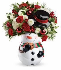 christmas floral arrangements christmas flower arrangements teleflora s sweet snowman bouquet