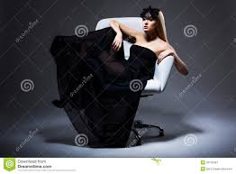 enjoyment classy elegant woman blonde relaxing in chair black