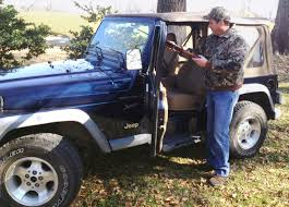 army jeep with gun quickdraw overhead gun rack for jeep wrangler great day inc