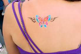 8 egyptian tattoos on back shoulder