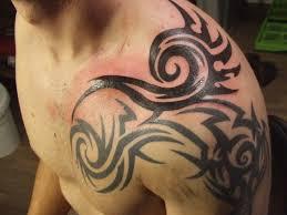 30 oustanding tribal shoulder tattoos slodive