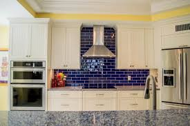 Coastal Kitchens - white and blue coastal kitchen with vetrazzo countertops