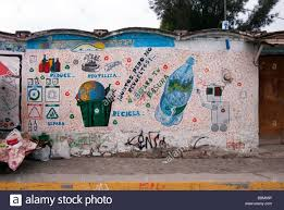 cheerful whimsical hand painted recycling mural on a village wall stock photo cheerful whimsical hand painted recycling mural on a village wall teotitlan oaxaca mexico