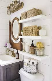country bathroom with shelves installed above toilet mirror