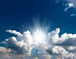 dramatic blue sky with clouds and sun rays stock photo colourbox