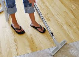 cleaning hardwood and tile floor with central vacuum cleaner