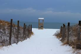 lifeguard stand in the snow at seagull beach yarmouth ma cape cod