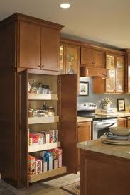 utility cabinets for kitchen make the most of tall cabinet storage with a utility cabinet
