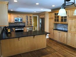 light wood kitchen pantry cabinet beautiful wood kitchen soapstone counters pantry stainless steel appliances bar green kitchens