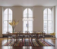 linear chandelier dining room transitional with eclectic dining