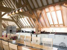 timber framed kitchen part of a large oak barn by carpenter oak