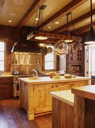 rural kitchen with hanging pot rack lighting over wooden island