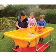 sand and water table with lid yellow cascade sand water table with red storage shelf