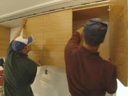 10 kitchen cabinet tips diy install the wall cabinets first