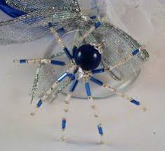 aqua spider ornament and suncatcher with by thespiderlady on etsy