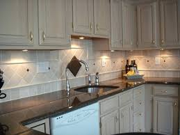 placement of pendant lights over kitchen sink kitchen sink lights multi colored tile steel appliances white