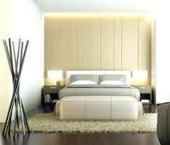 meuble chambre adulte murs dans la chambre a coucher en gris poussiare et meubles blancs