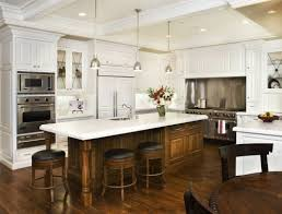 white kitchen wood island hearth range and side cabinets stained wood island