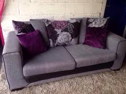 grey fabric 3 seater sofa with black trim and purple black grey